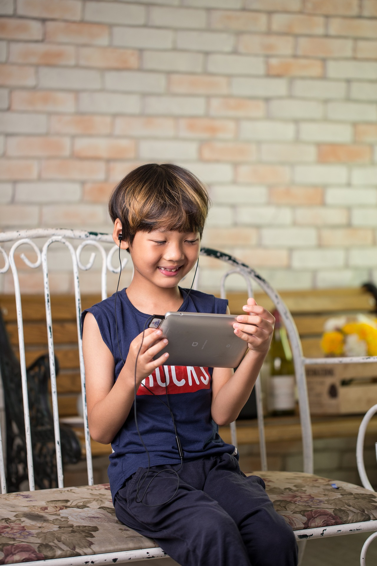 child screen time tablet playing happy