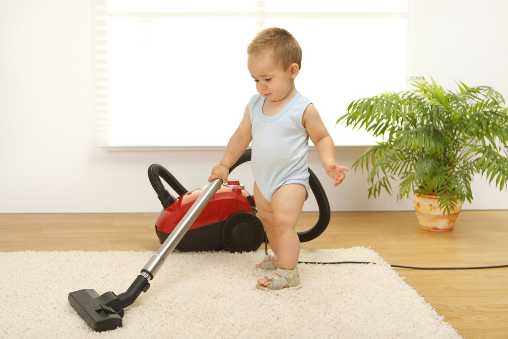 child hoovering
